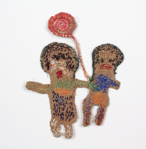 Image of Jane Ryan artwork made of wire, hessian and wool, featuring a man and woman holding a shared flower.